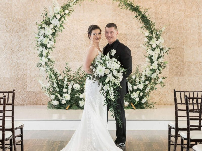 Happy couple holding flowers